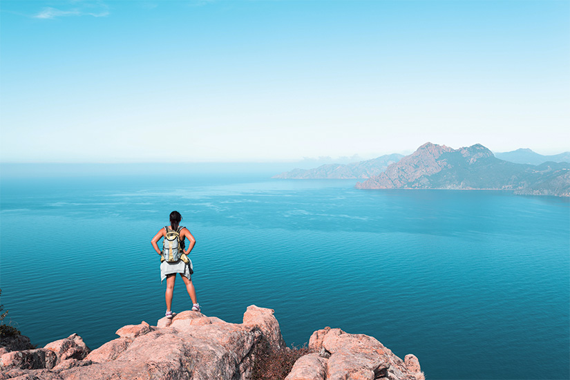 (image) image Randonneuse regardant la vue a Calanques de Piana en Corse France 91 as_206464483